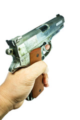 Gun in hand.