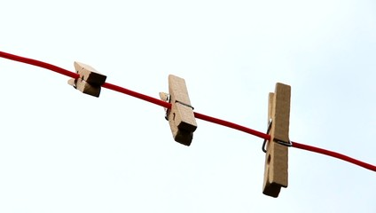 Pegs on a Clothesline - Waving  in the Wind