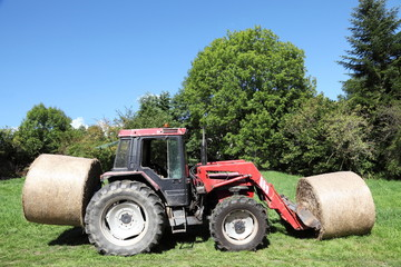 Tractor Loaded With Hay Bales