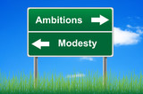 Ambitions modesty signpost on sky background, grass underneath. poster