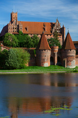 Malbork castle and reflection