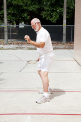 Fit Senior Man Playing Racquetball