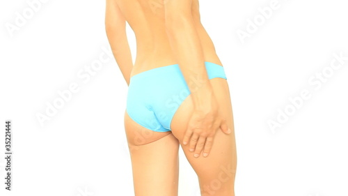Woman applying moisturizer cream on buttock, isolated