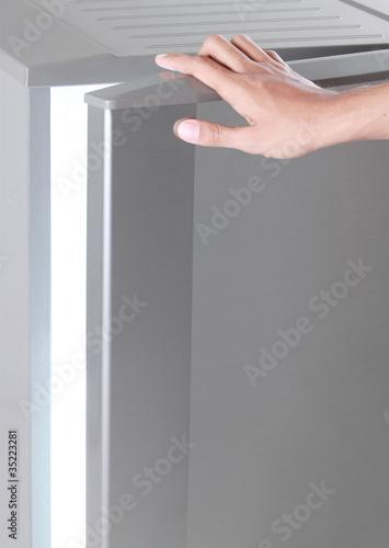 hand open freezer