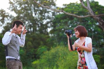 man and women take a photo