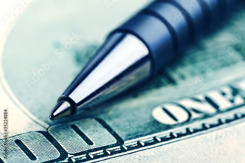 close-up pen on the money