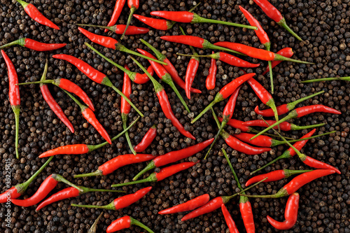 red peppers on black peppercorns|35225615