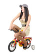 Young girl on a children's bicycle on withe