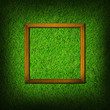wood frame on green grass field background