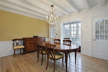 Dining room with white wood ceiling beams