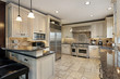 Upscale kitchen with breakfast bar - 35231830