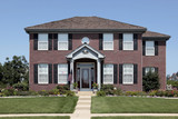 Brick home with arched entry