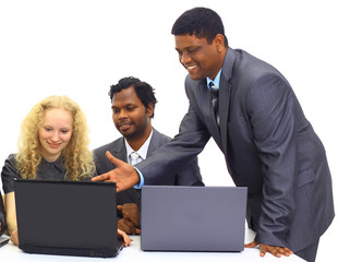 Interracial business team working at laptop in a