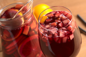 Red wine punch called sangria with orange, apple, mango