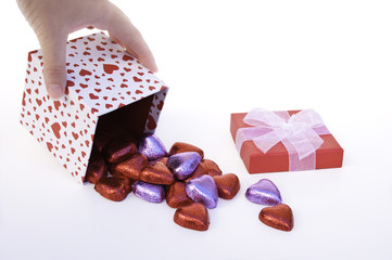 Hand Tipping Heart Gift Box Spilling Chocolates