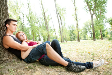 young couple relaxing in park