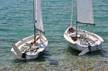 Two white small sailboads