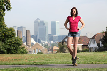 Beautiful girl on roller skates in London England