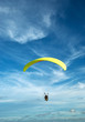 Flying paramotor in the blue sky