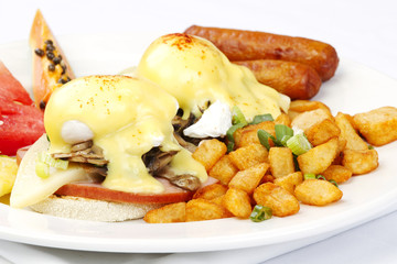 Mushroom ham and cheese eggs benedict