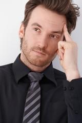 Portrait of thinking businessman