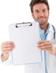 Handsome doctor holding blank sheet smiling