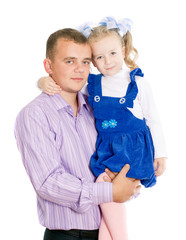 a young father  holds daughter on hands