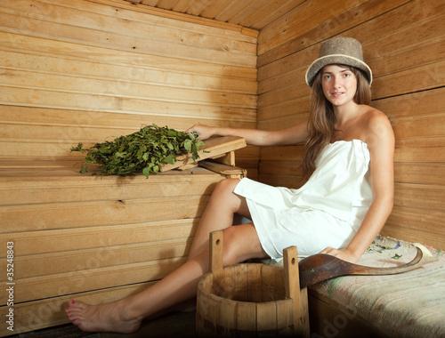 girl in white sheet  at  sauna