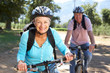 canvas print picture - Senior couple on country bike ride
