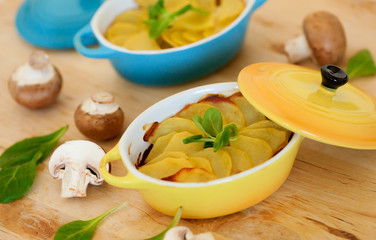 Delicious potato gratin in colorful ramekins