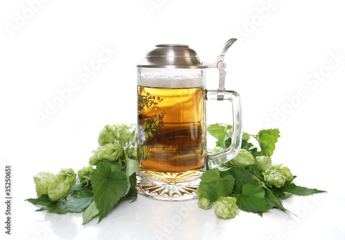 Beer in beer mug with pewter lid