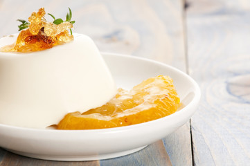 Vanilla Panna Cotta Dessert with lemon and fresh herbs