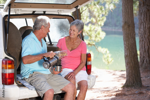 Fotobehang Picknick Senior couple on country picnic