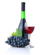 Bottle and goblet of red wine with banch of grapes isolated