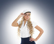 Sexy female sailor on a grey background