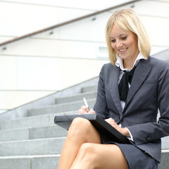 Young blond businesswoman working in formal clothes