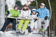 Ski lift - happy family on ski  vacation