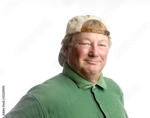 middle age senior man wearing casual hat smiling