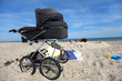 Baby carriage on a sandy beach