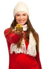 Beautiful woman holding small golden Christmas gift