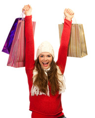 Beautiful young woman happy to finish christmas shopping