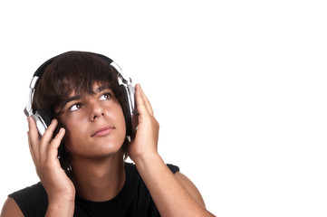 young boy listening to music with headphones
