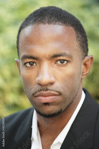 Image of a handsome black man with a mustache