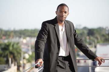 Young black businessman by the ledge