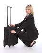 Beautiful young blonde business woman travelling