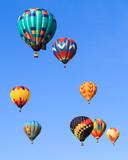 hot air balloons over blue sky