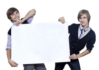 Two young guys hold blank sheet / white poster