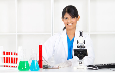 pretty indian female science researcher in lab