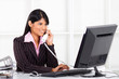 young businesswoman on the phone in office