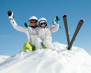 Happy skiers portrait